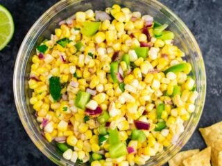 The best easy fresh corn salsa recipe made with just a few ingredients. It tastes better than chipotle and is ready in minutes! Make your own burrito bowls at home with this awesome corn salsa. #chipotlecornsalsa #cornsalsa #chipotle #burritobowl #appetizer #vegan #corn #appetizer