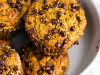 Healthy chocolate chip zucchini muffins made with easy ingredients. Perfect for using up all of that summer zucchini! #zucchini #muffins #chocolatechip #healthy #breakfast #vegetarian