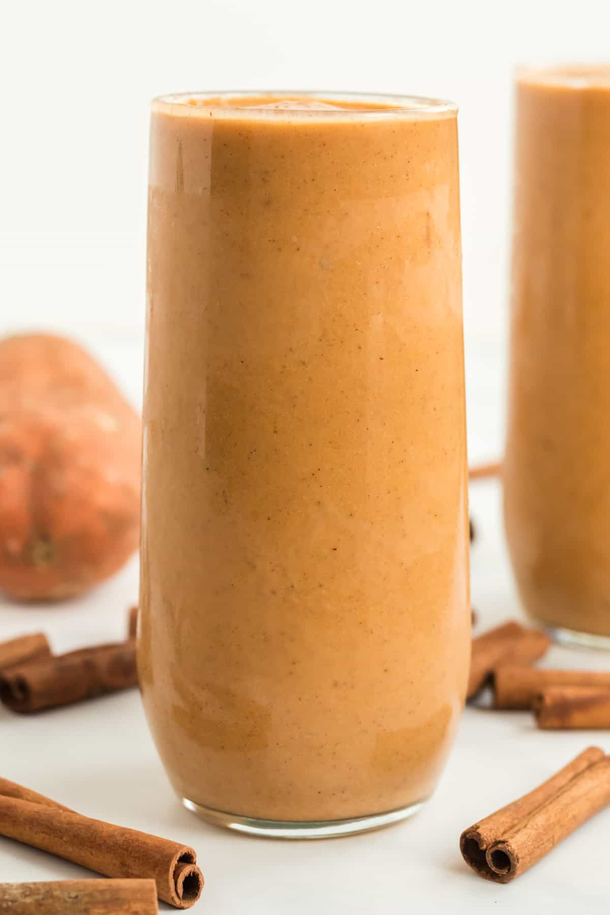 tall glass filled with sweet potato smoothie