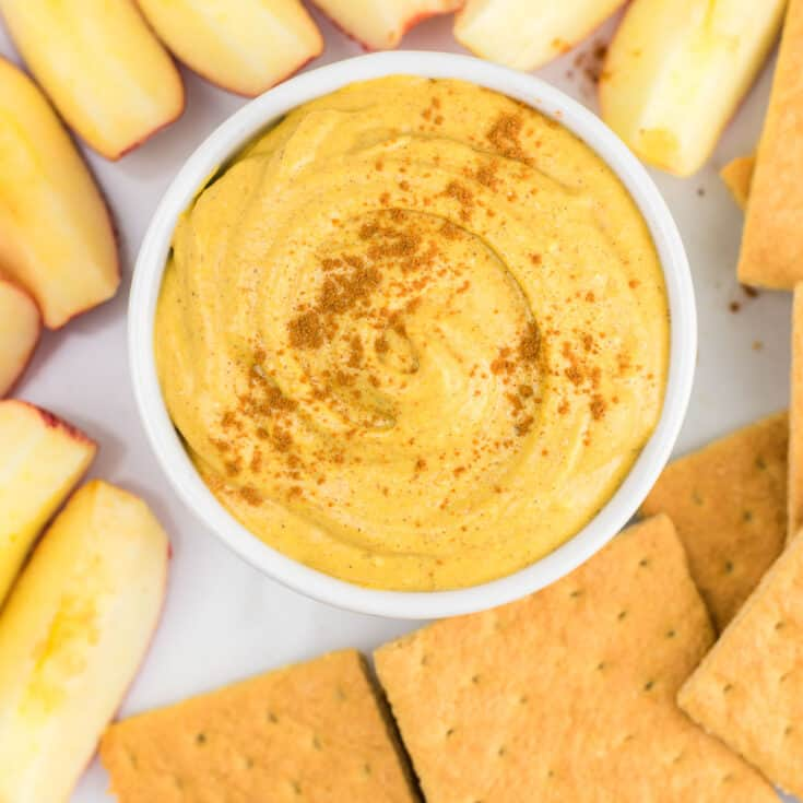 pumpkin cream cheese dip with graham crackers and apple slices