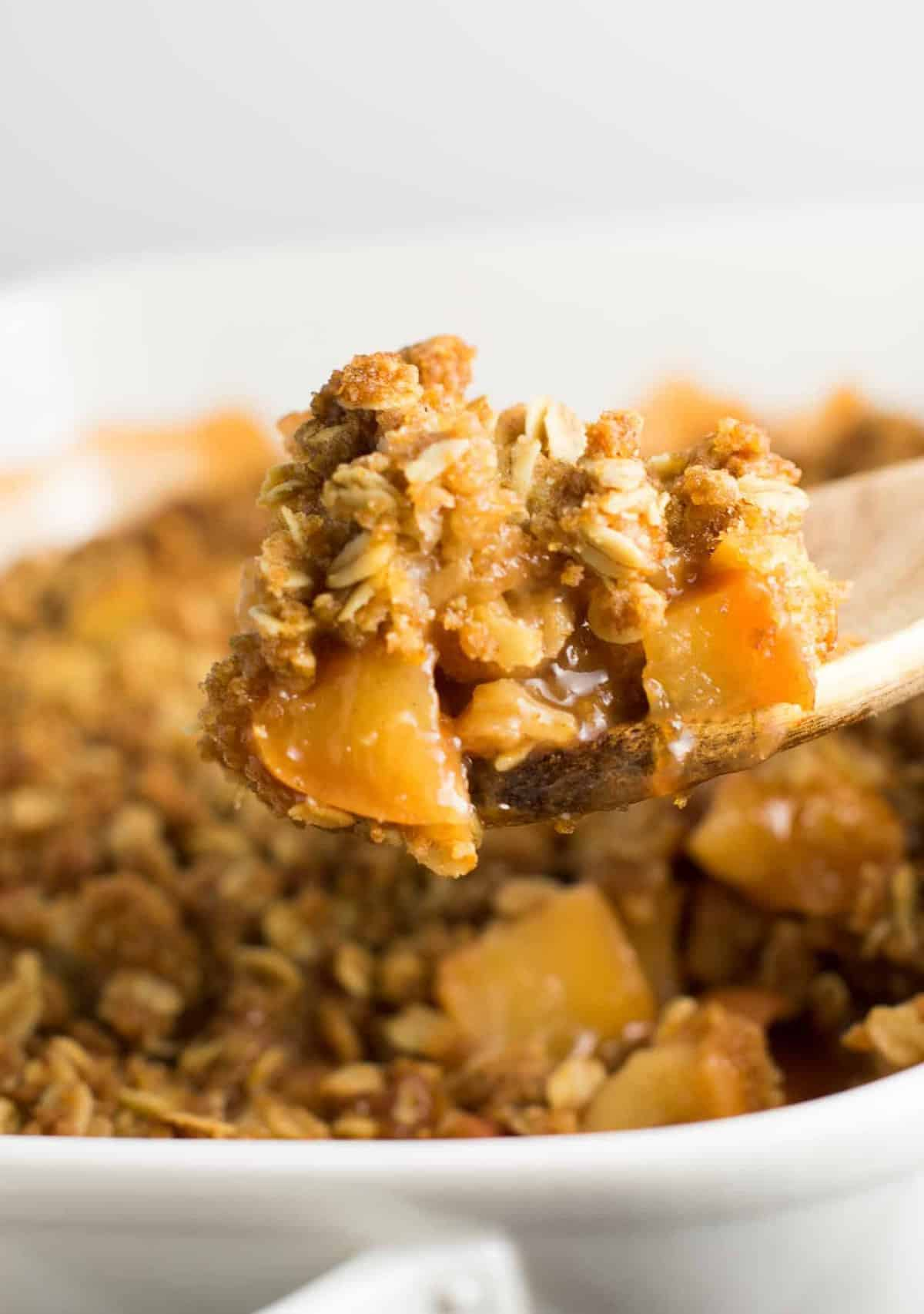 dairy free apple crisp being served on a spoon
