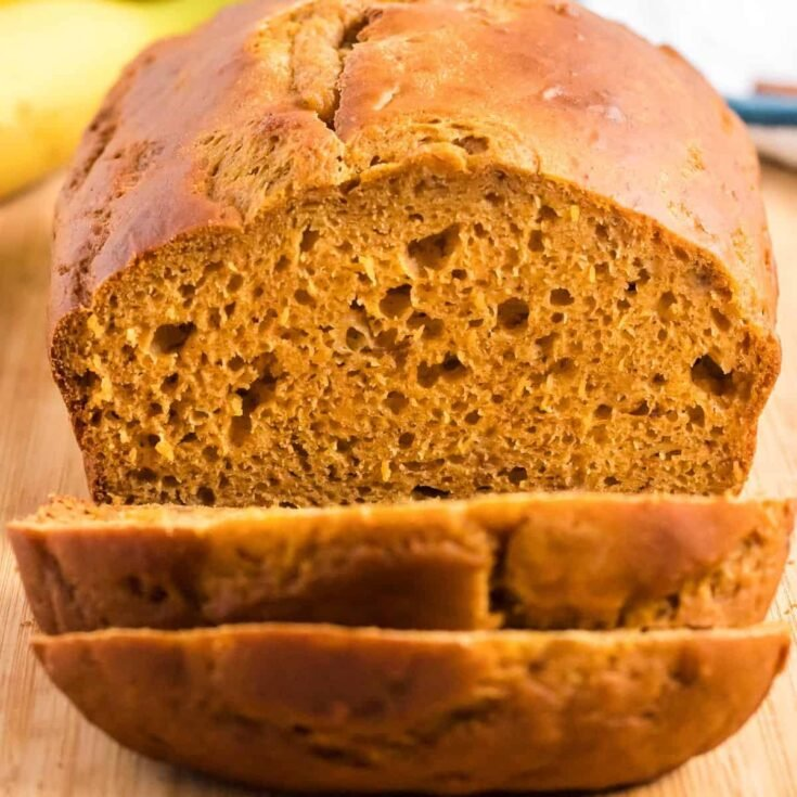 pumpkin bread being cut into slices