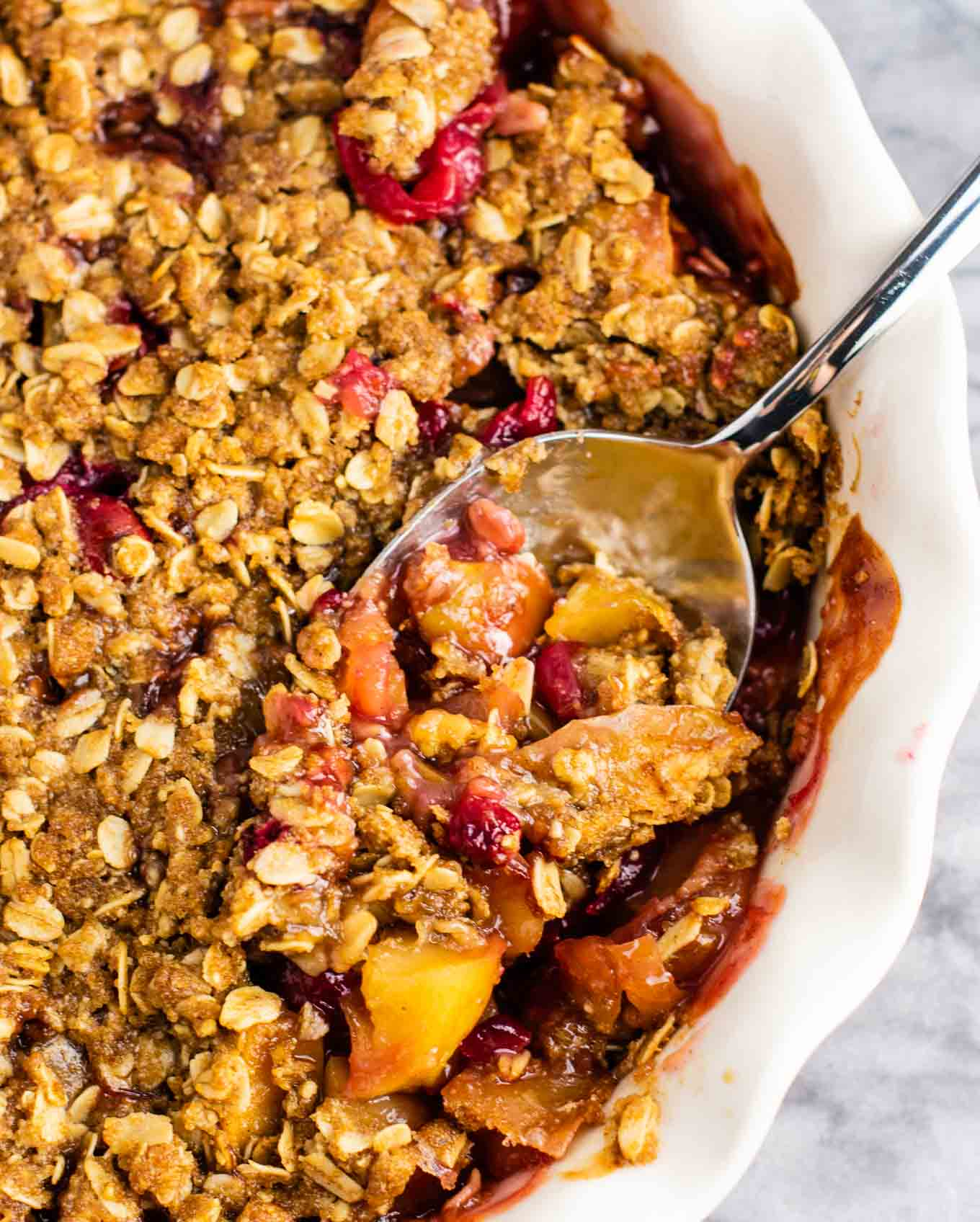 Fresh cranberry apple crisp with a gluten free oat topping. This is AMAZING! Make this for Thanksgiving, Christmas, or any day in between! #cranberry #cranberryrecipe #cranberryapplecrisp #dessert #glutenfree #glutenfreedessert