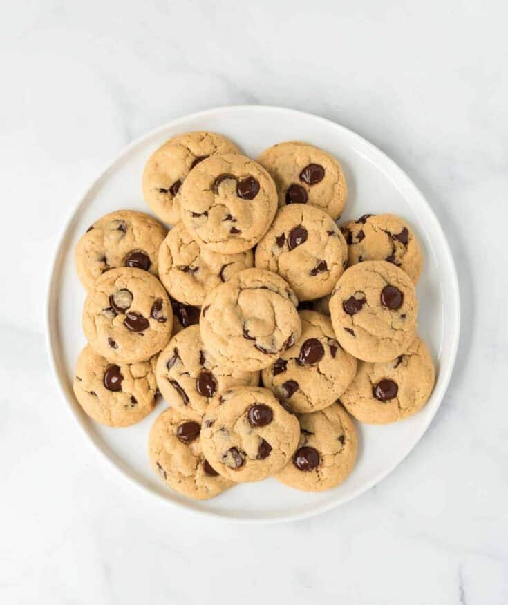 vegan chocolate chip cookies stacked on a plate