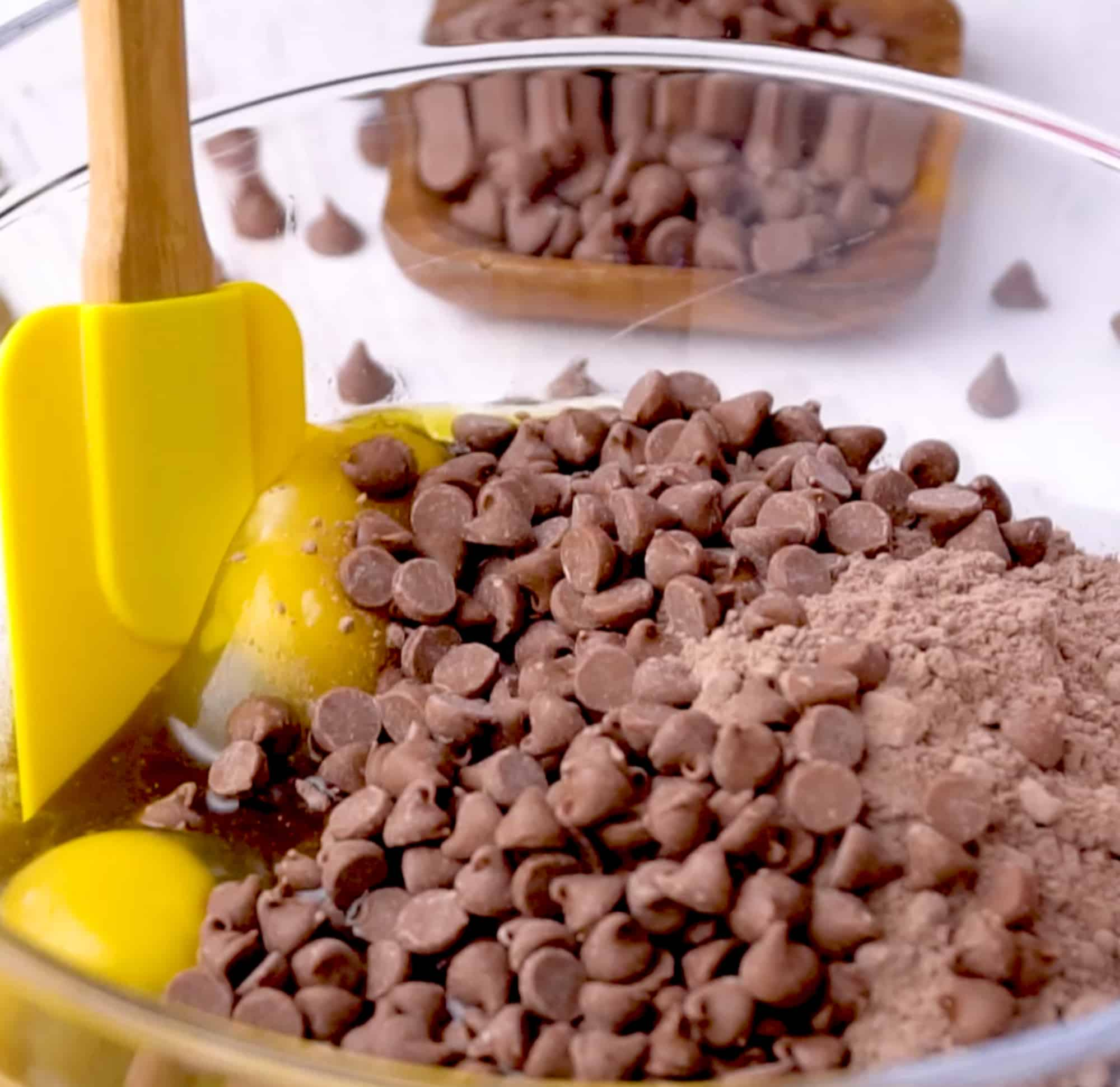the ingredients in the bowl with a rubber spatula