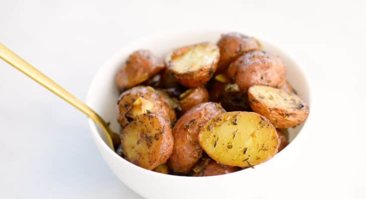 roasted potatoes in a white bowl