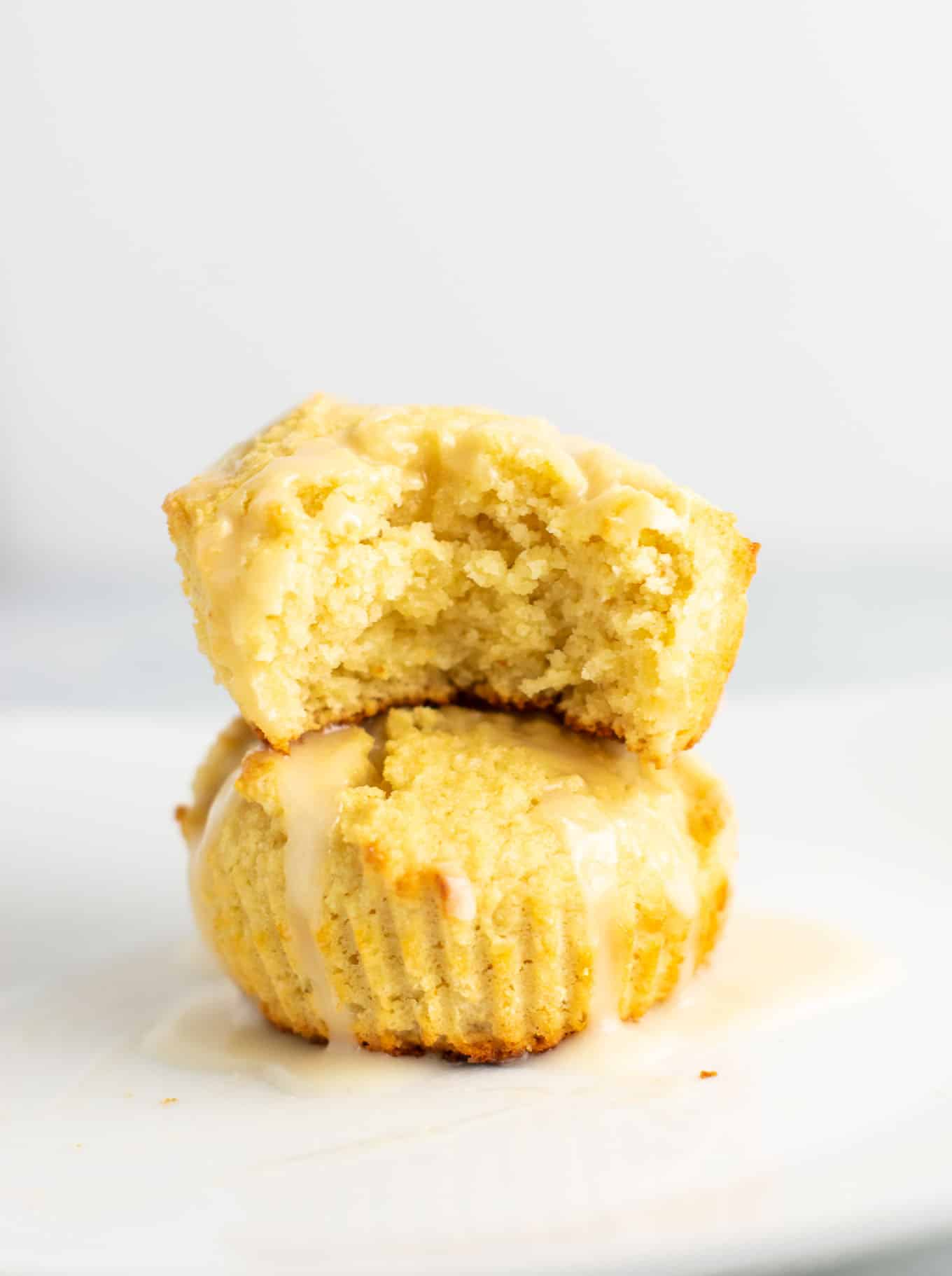 Gluten free lemon muffins with a sweet lemon glaze. These are perfectly fluffy, do not fall apart, and taste amazing! #glutenfree #lemonmuffins #breakfast