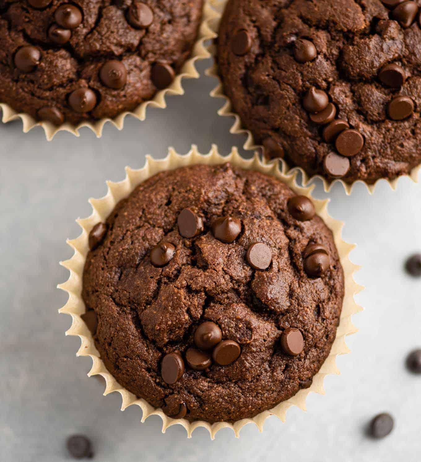 gluten free chocolate muffins from an overhead view topped with melted mini chocolate chips