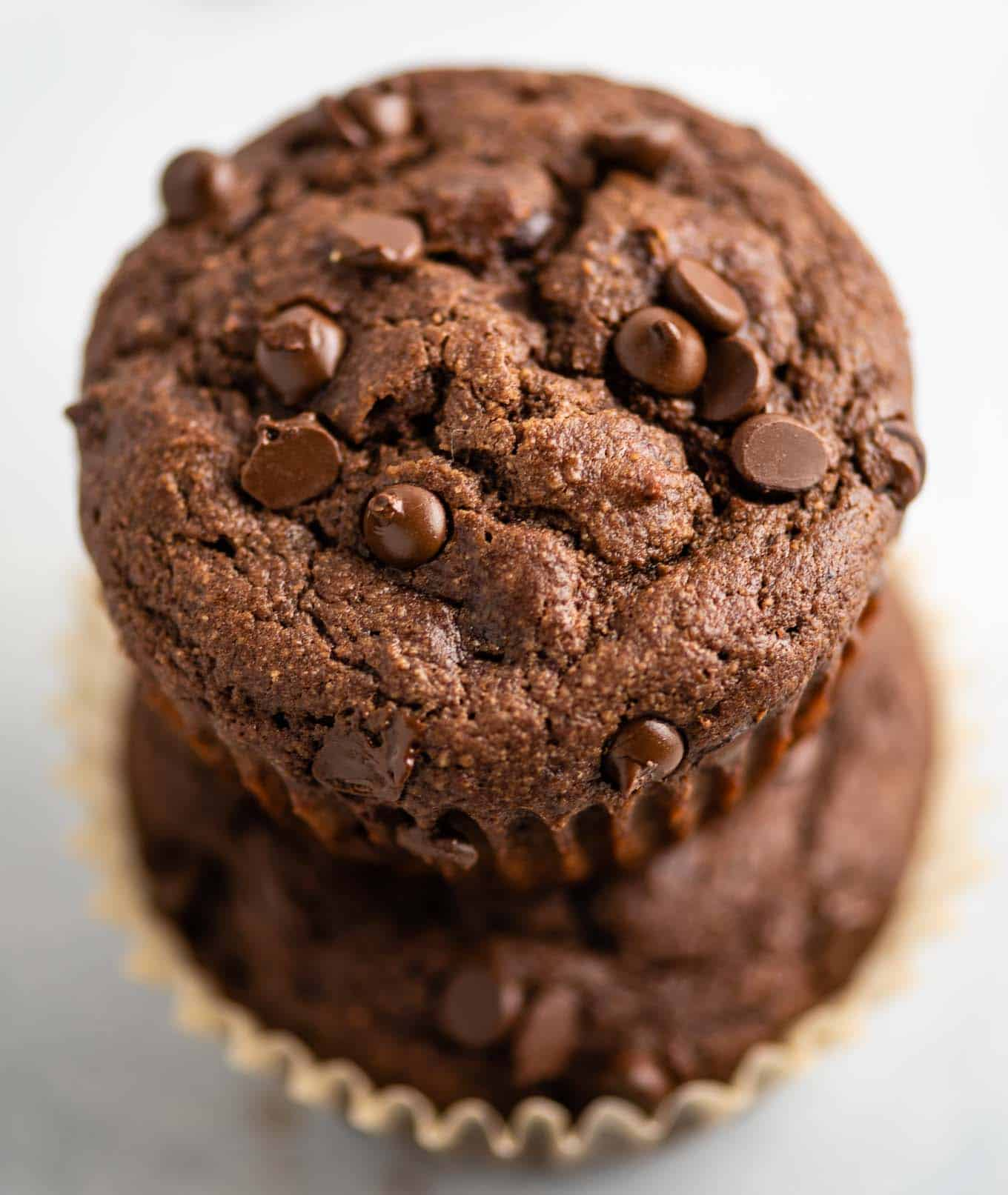 two stacked chocolate muffins