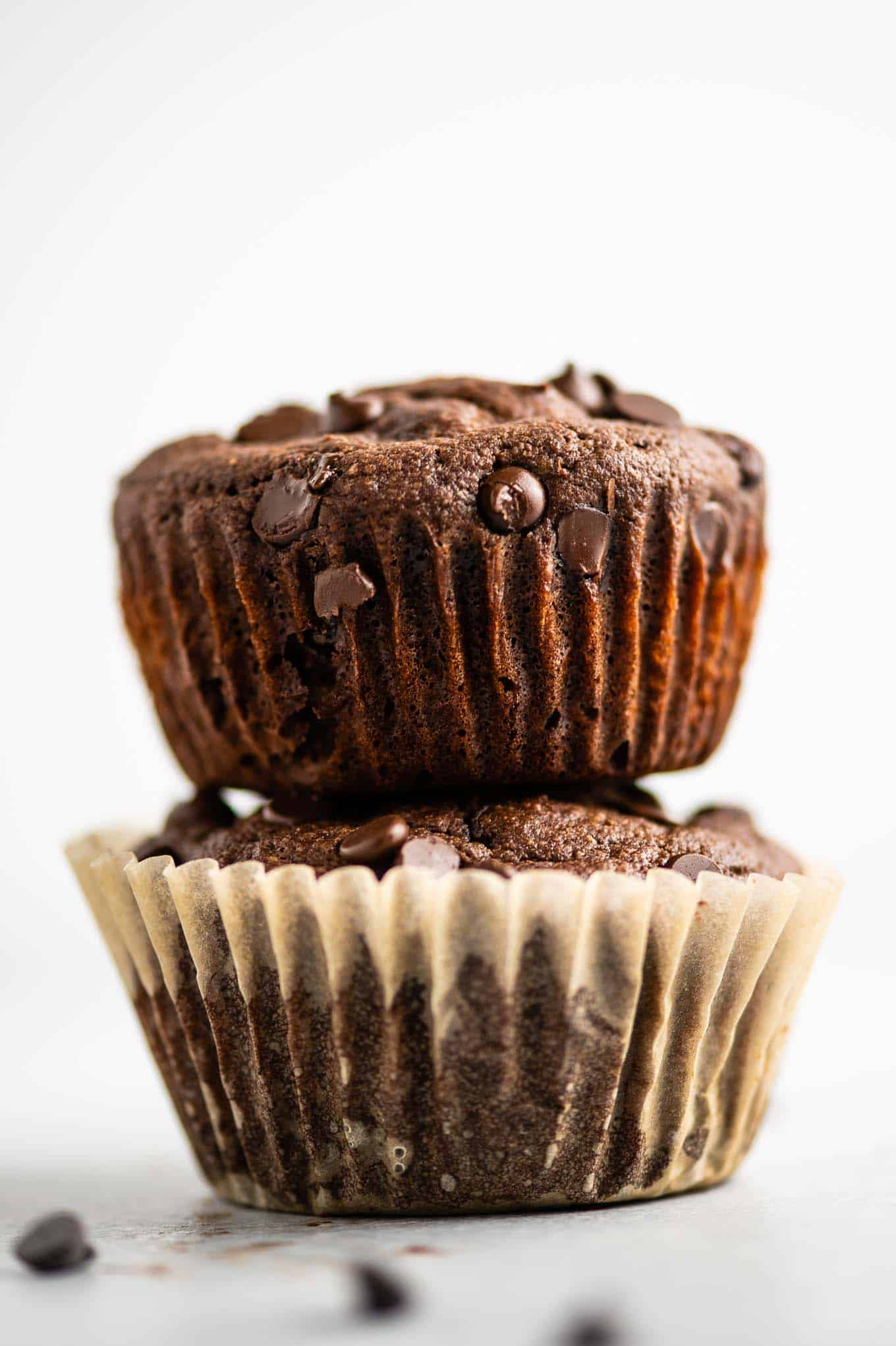 two gluten free chocolate muffins stacked