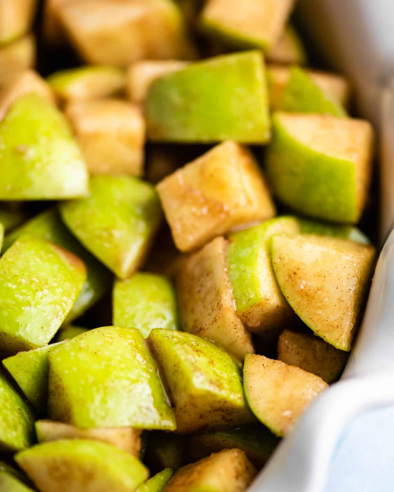 cut up apples with cinnamon, brown sugar, lemon juice, salt, and cornstarch