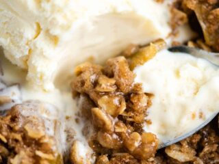 gluten free apple crisp with ice cream on a spoon
