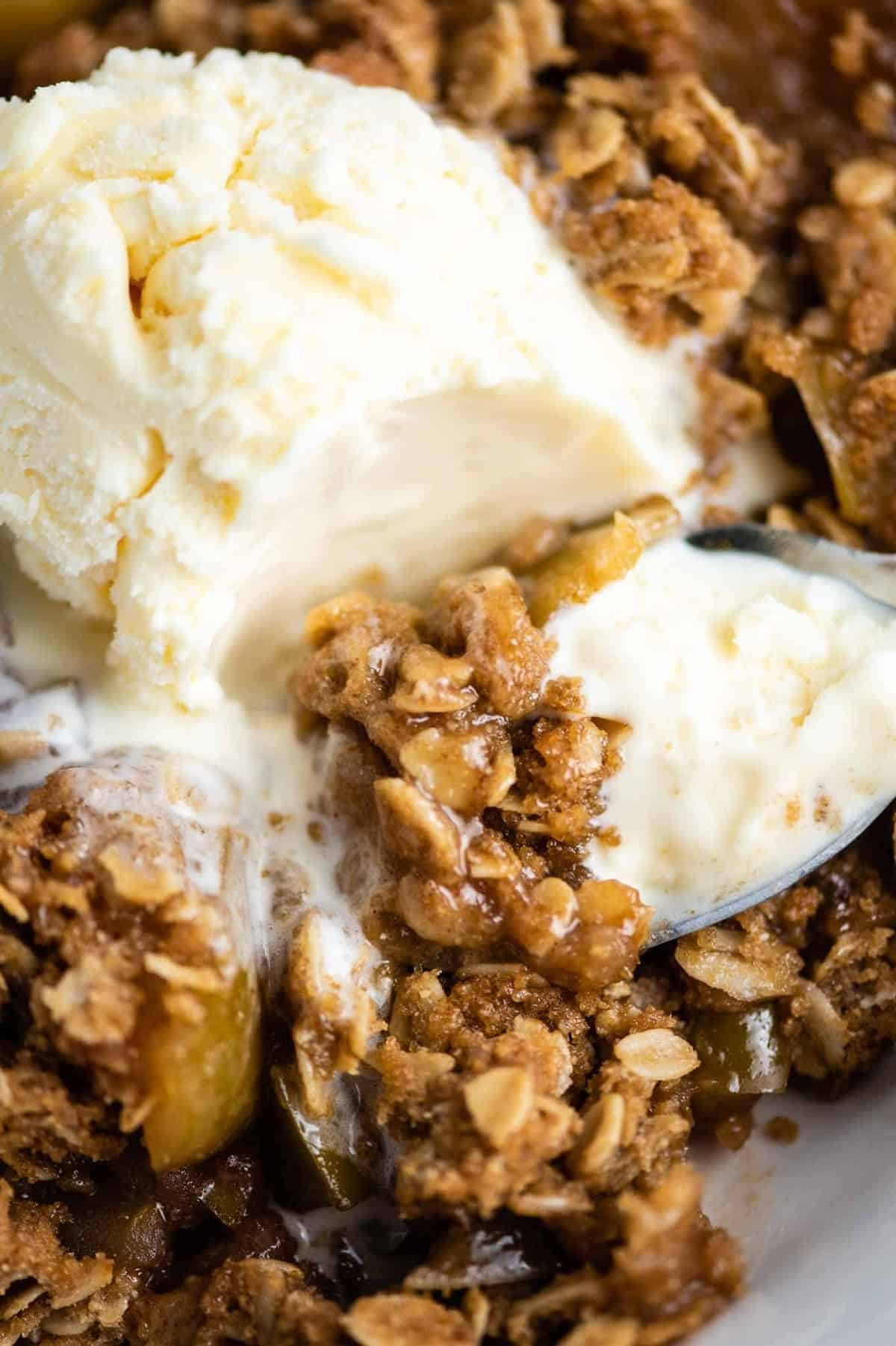gluten free apple crisp with ice cream on a spoon