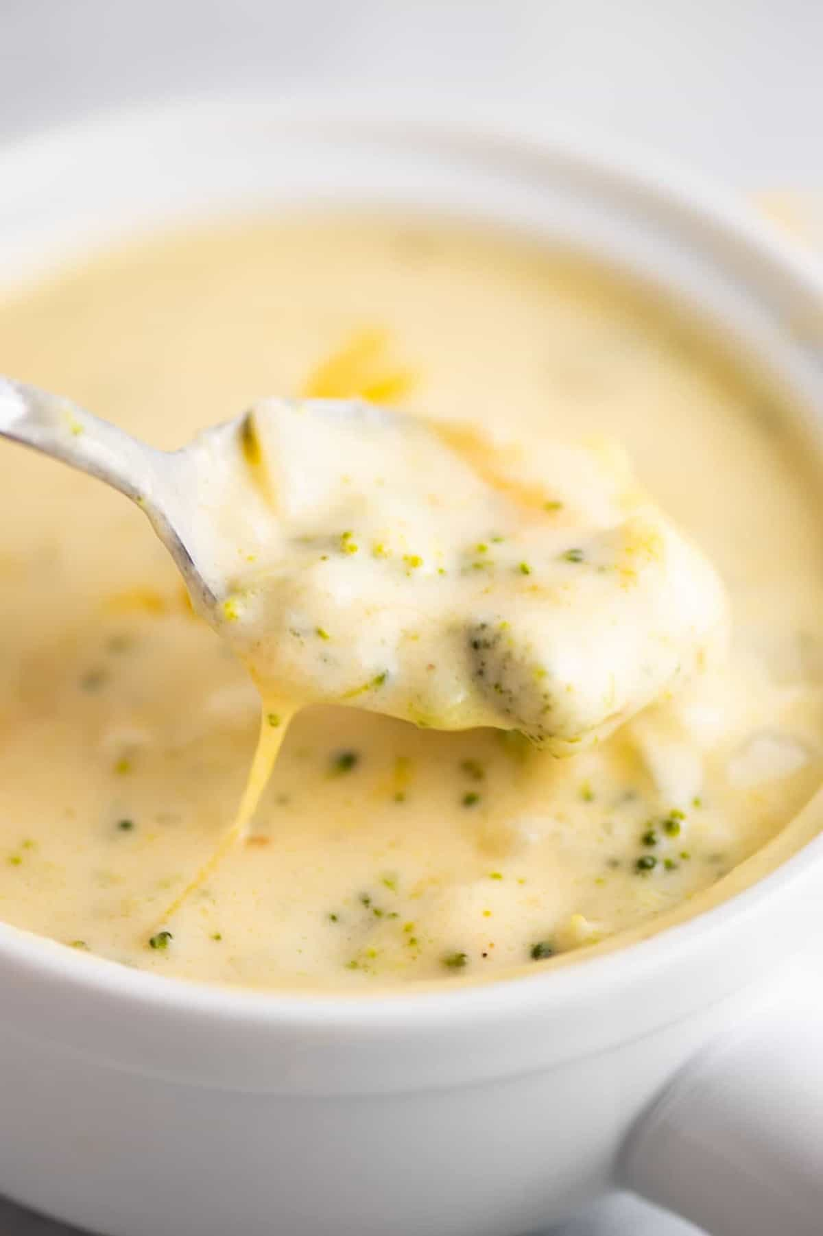 a spoonful of cheddar cheese and broccoli soup