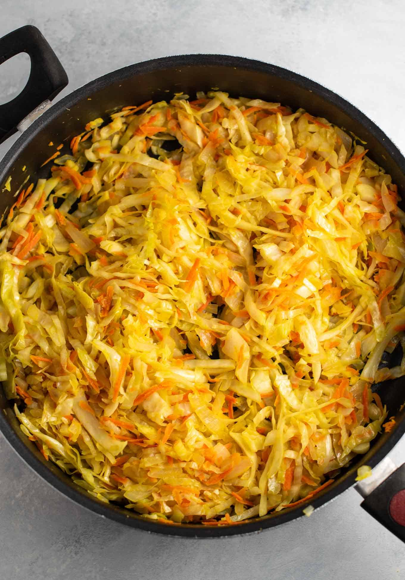 cooked cabbage, carrots, ginger, and onion