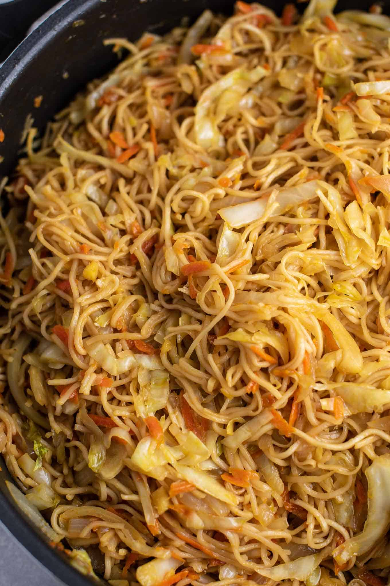 stir fried cabbage and noodles in the skillet