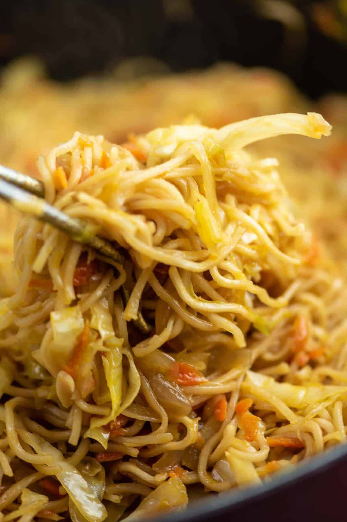 ramen noodles, cabbage, and carrots in a dish