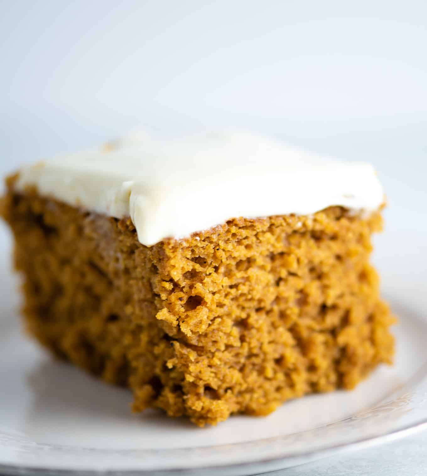 pumpkin cake slice with cream cheese frosting