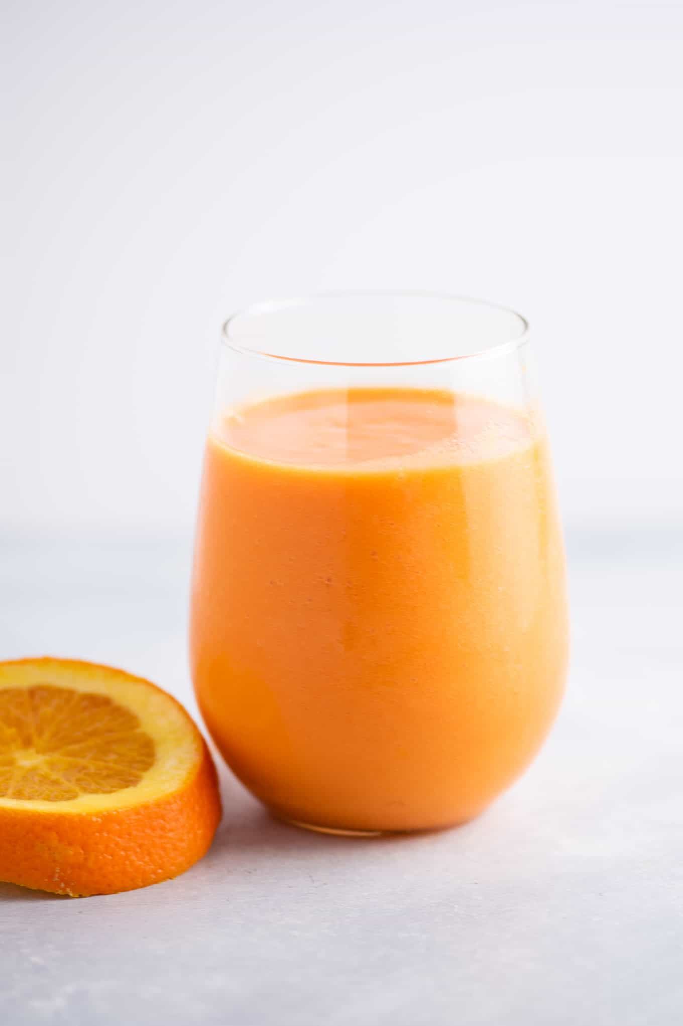 carrot orange ginger smoothie in a glass