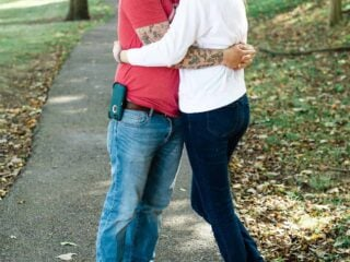 image of a couple hugging in a park