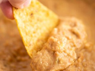 a chip dipping bean dip