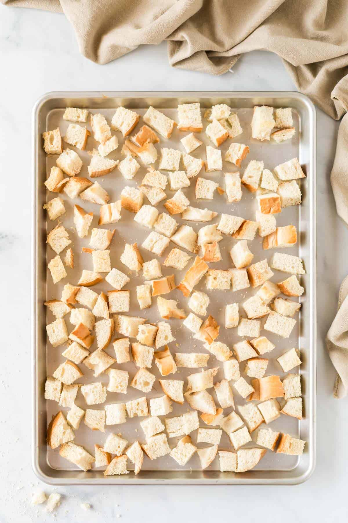cubed bread on a baking sheet