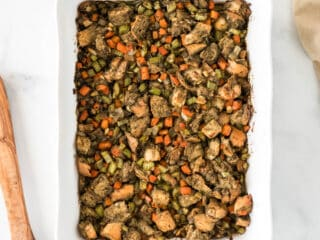 vegan stuffing in a white casserole dish