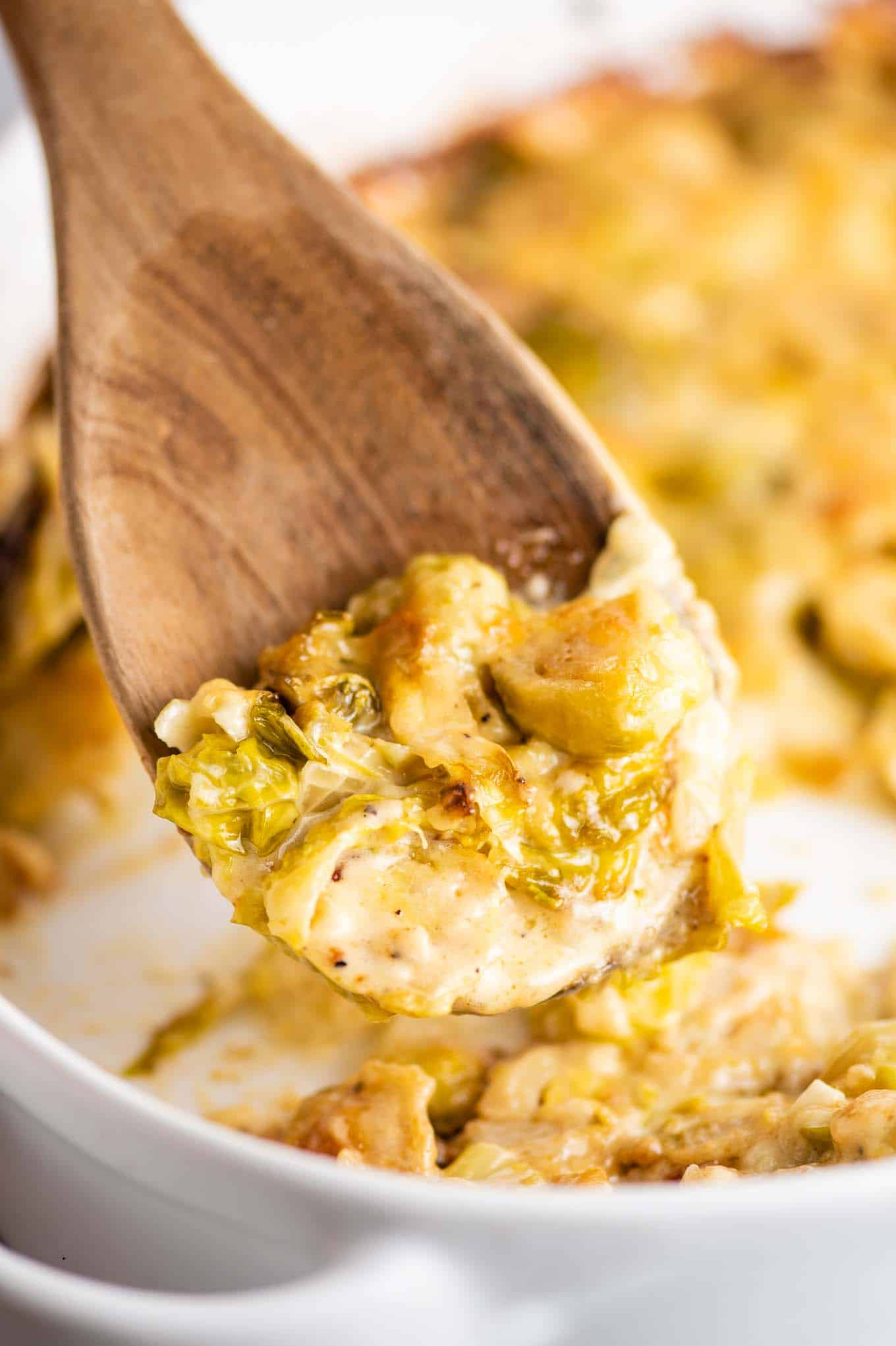 brussels sprouts gratin on a wooden spoon