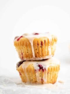 two muffins stacked with glaze dripping down the side