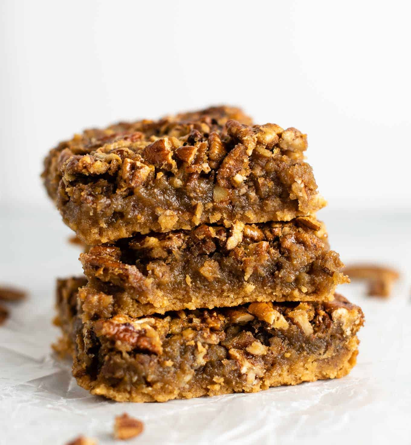 a stack of three pecan pie bars