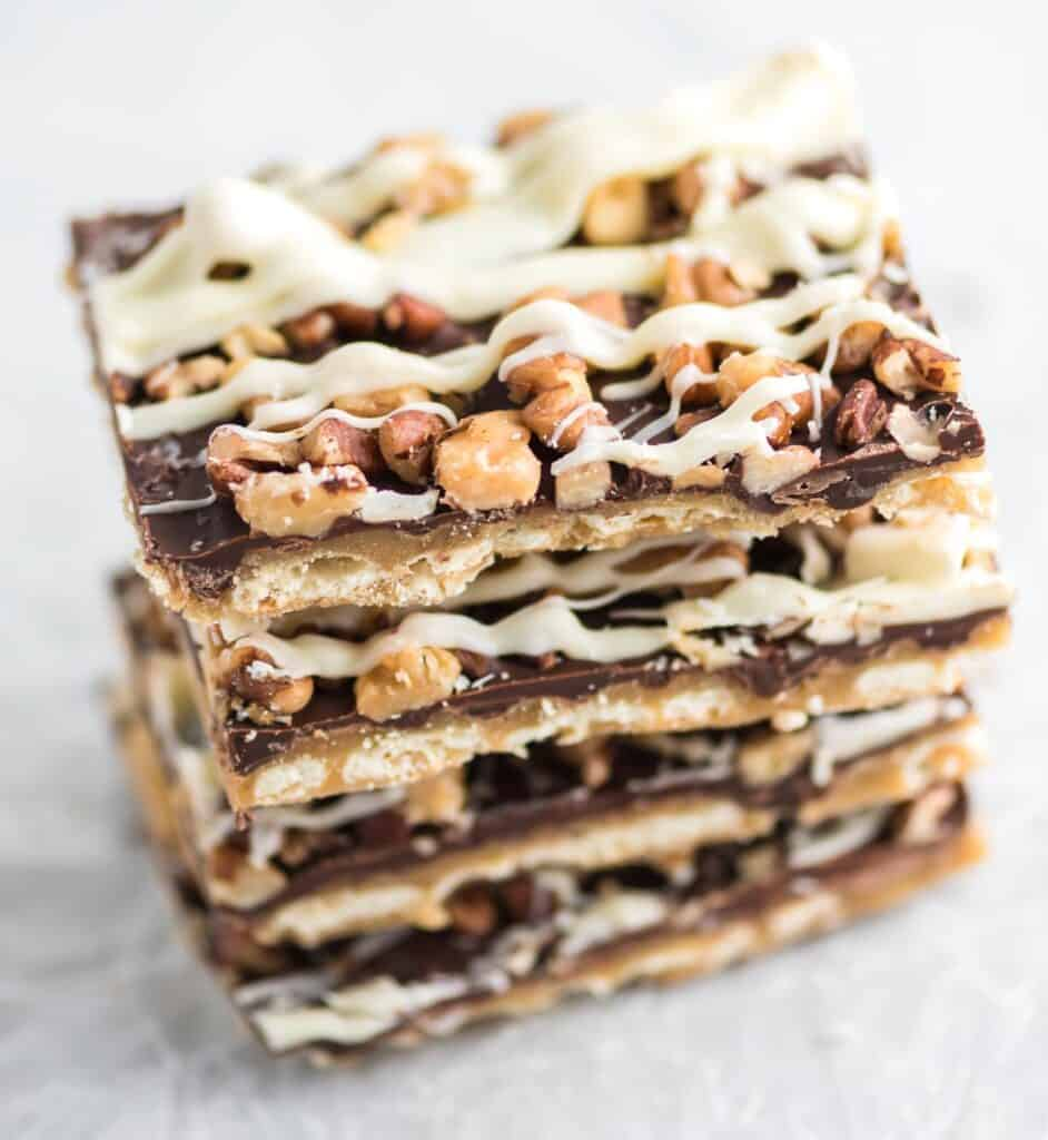 christmas crack topped with walnuts, pecans, and drizzled white chocolate