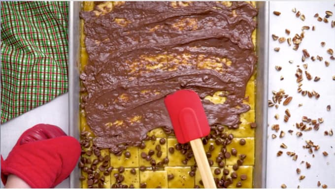 spreading the chocolate chips with a spatula