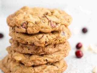 5 stacked white chocolate cranberry pecan cookies