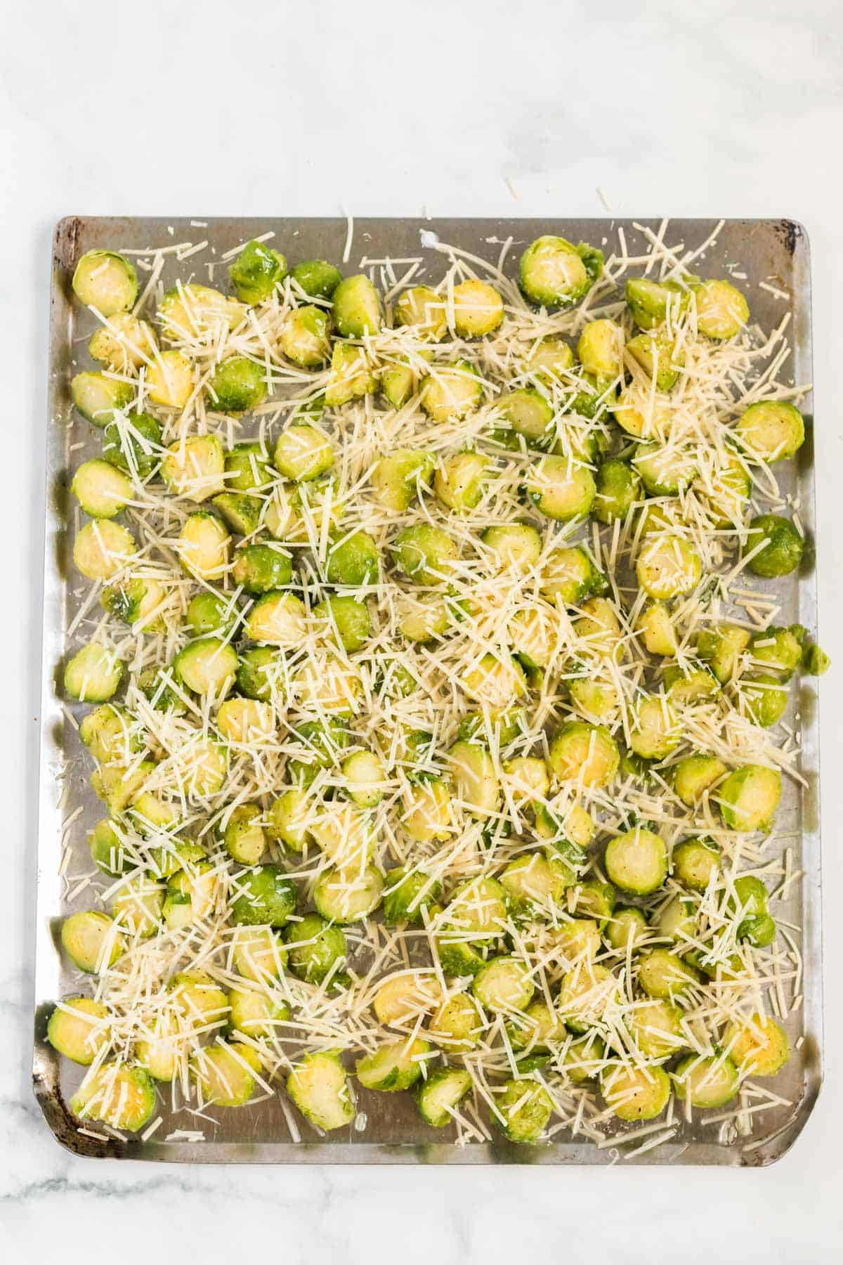 brussels sprouts cut in half and topped with parmesan cheese