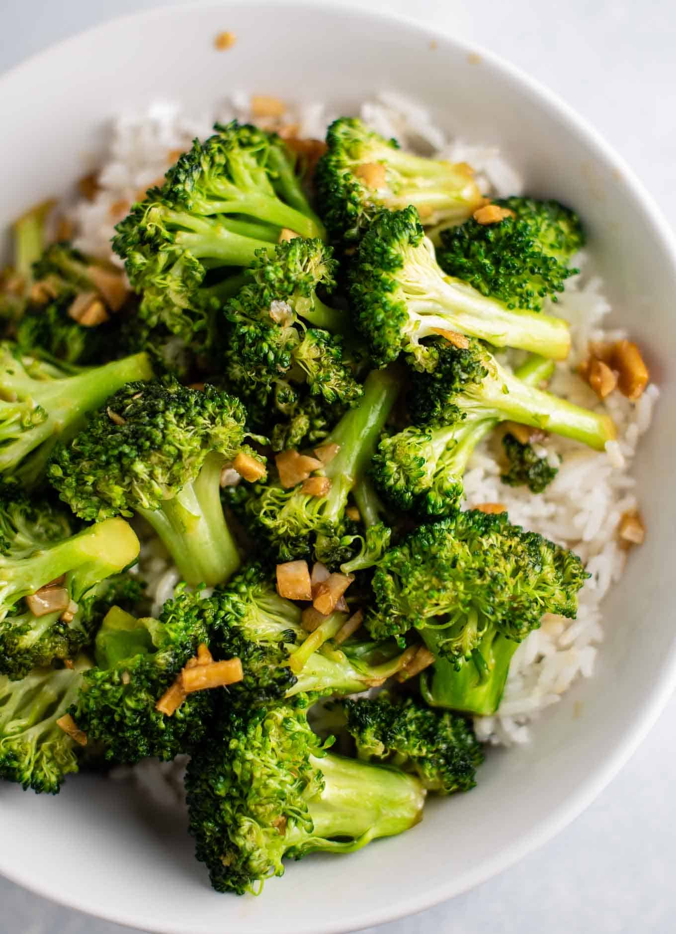 broccoli stir fry with white rice in a white bowl