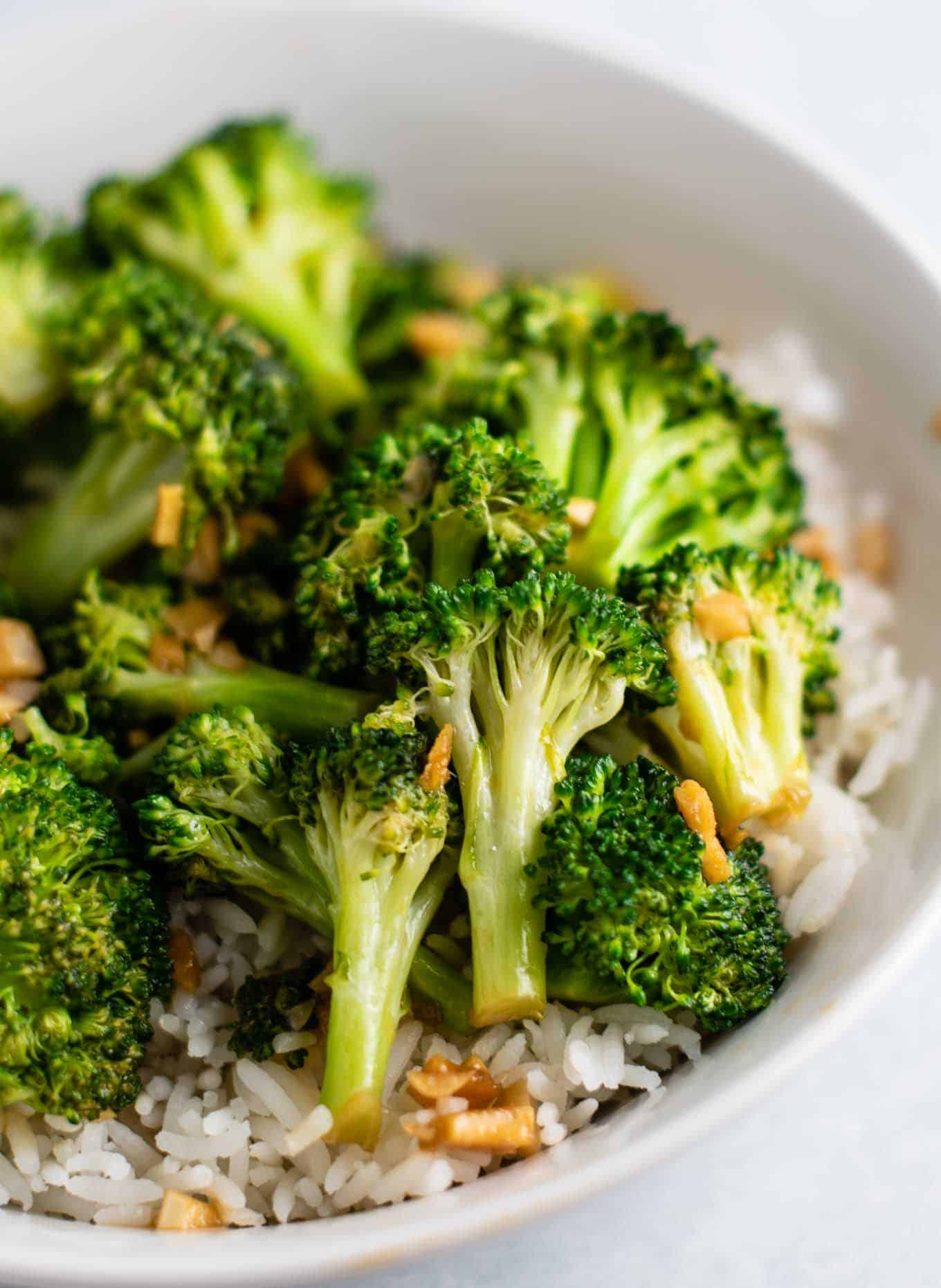 broccoli over rice in a white bowl