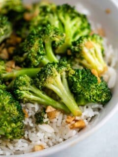 broccoli stir fry over rice in a white bowl