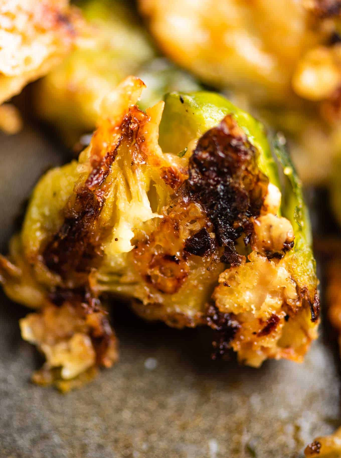 up close picture of a roasted brussel sprout with crispy edges