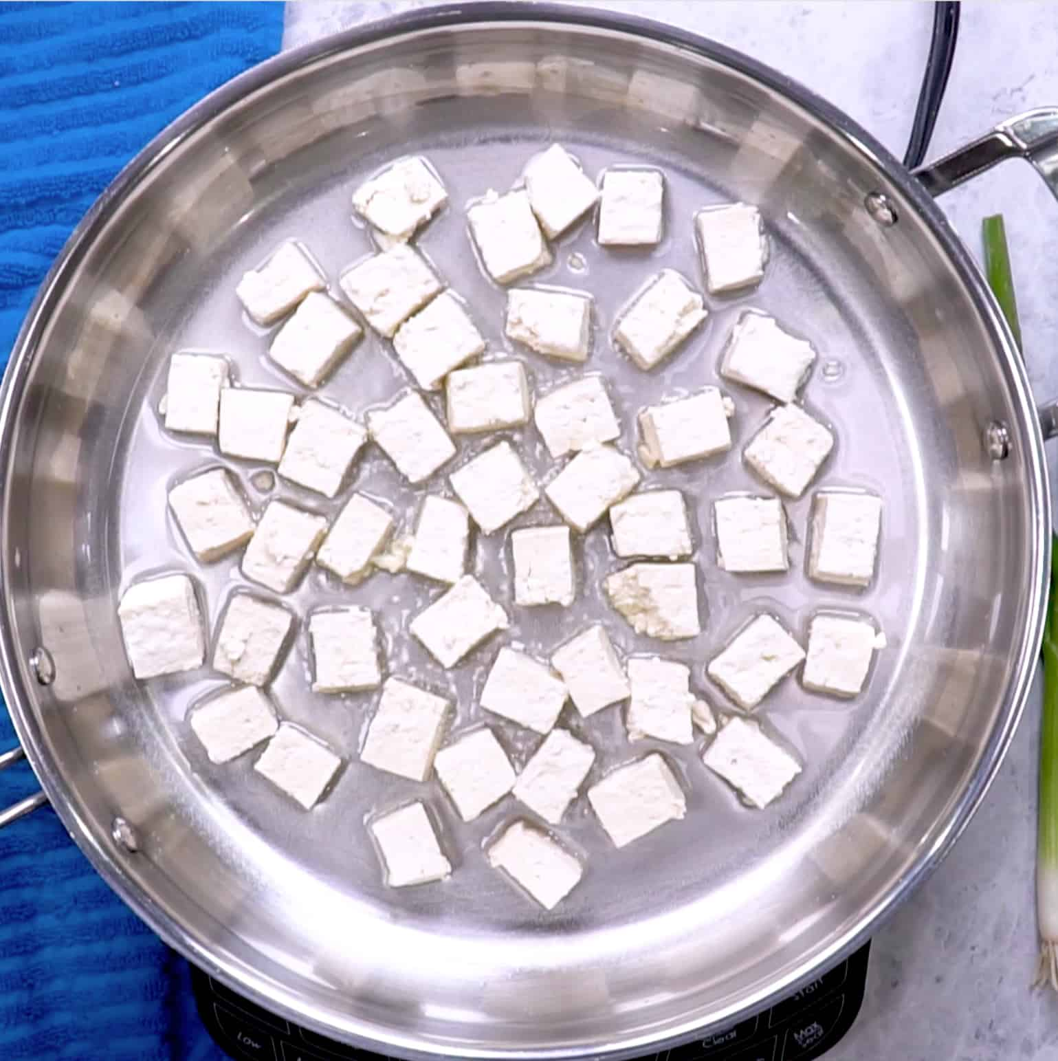cooking tofu in a skillet