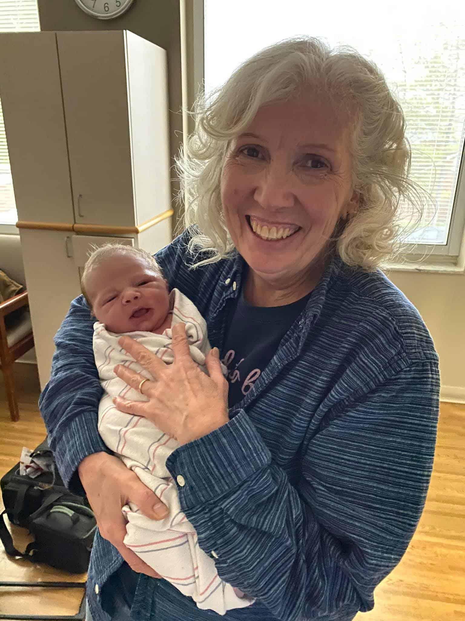 debbie perdew doula holding newborn baby boy Hudson