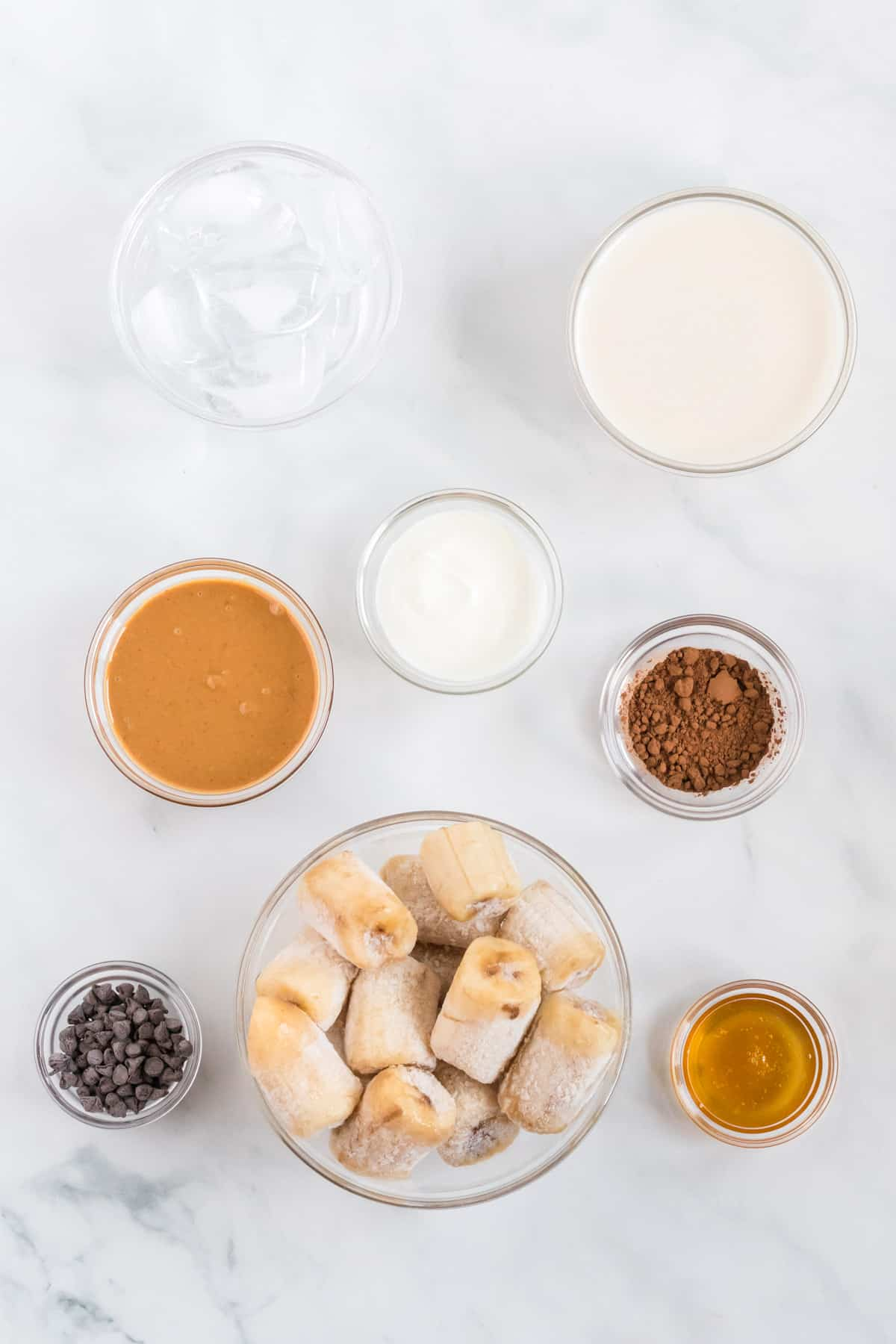 ingredients to make a chocolate peanut butter banana smoothie
