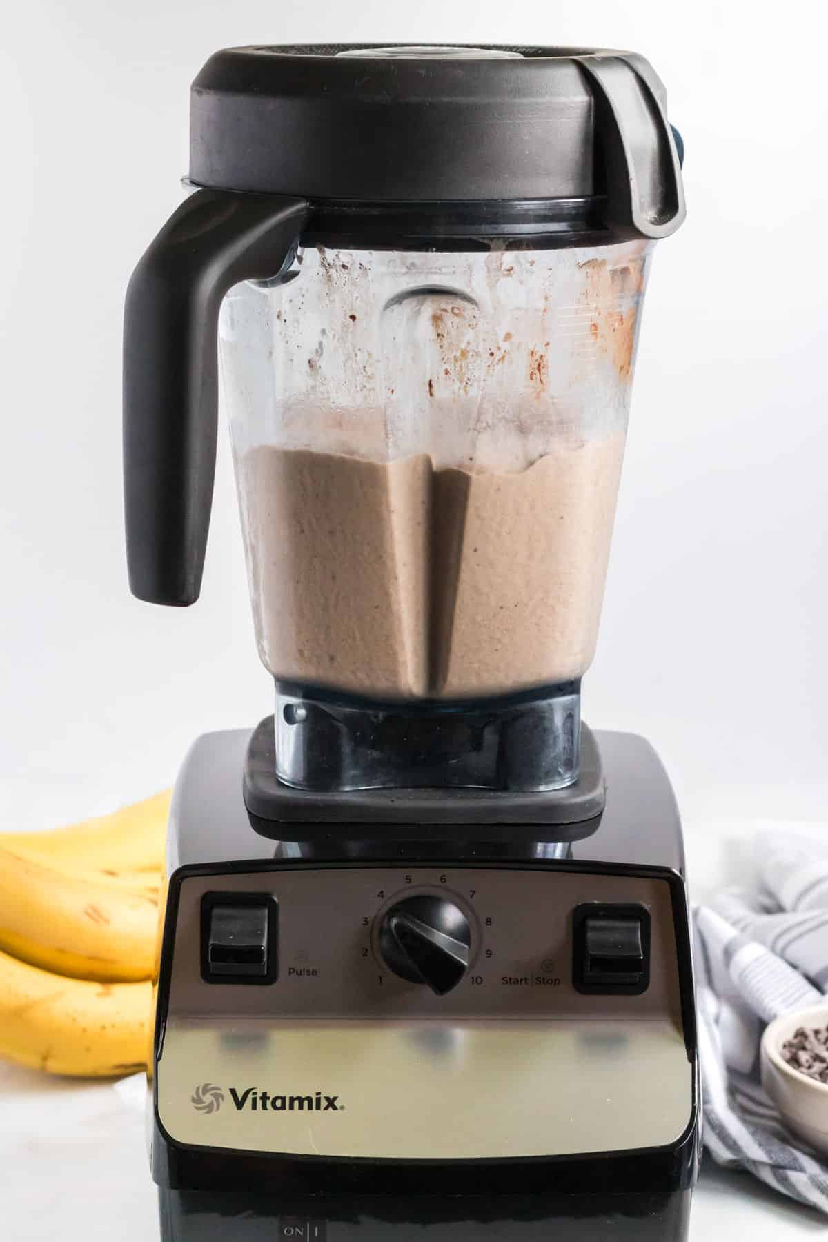 blended healthy chocolate peanut butter banana smoothie in the blender