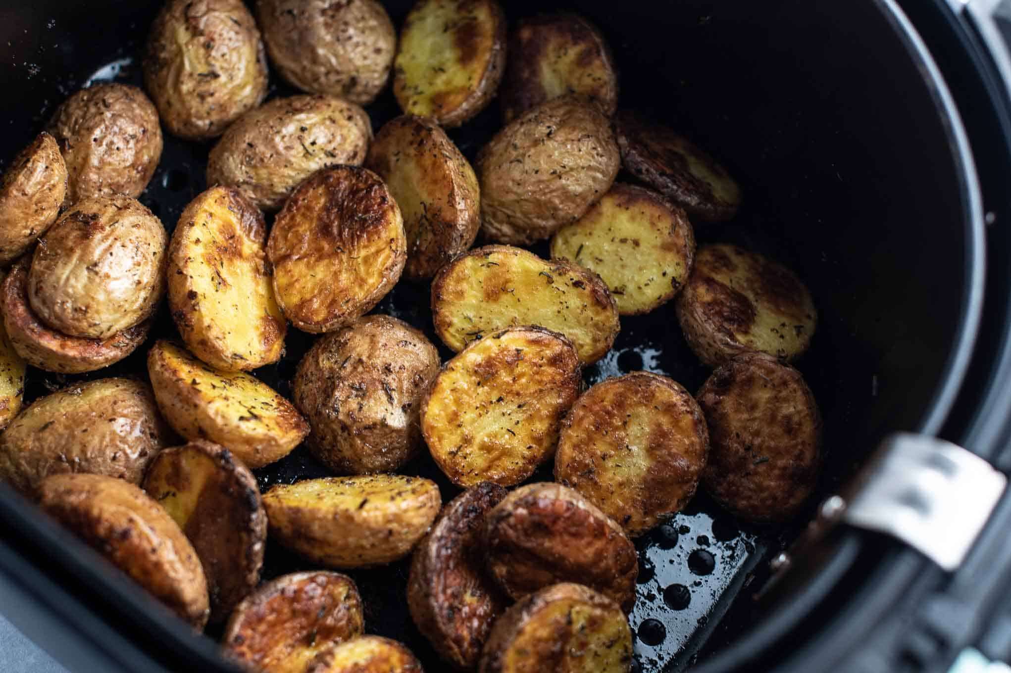 air fryer with potatoes in it