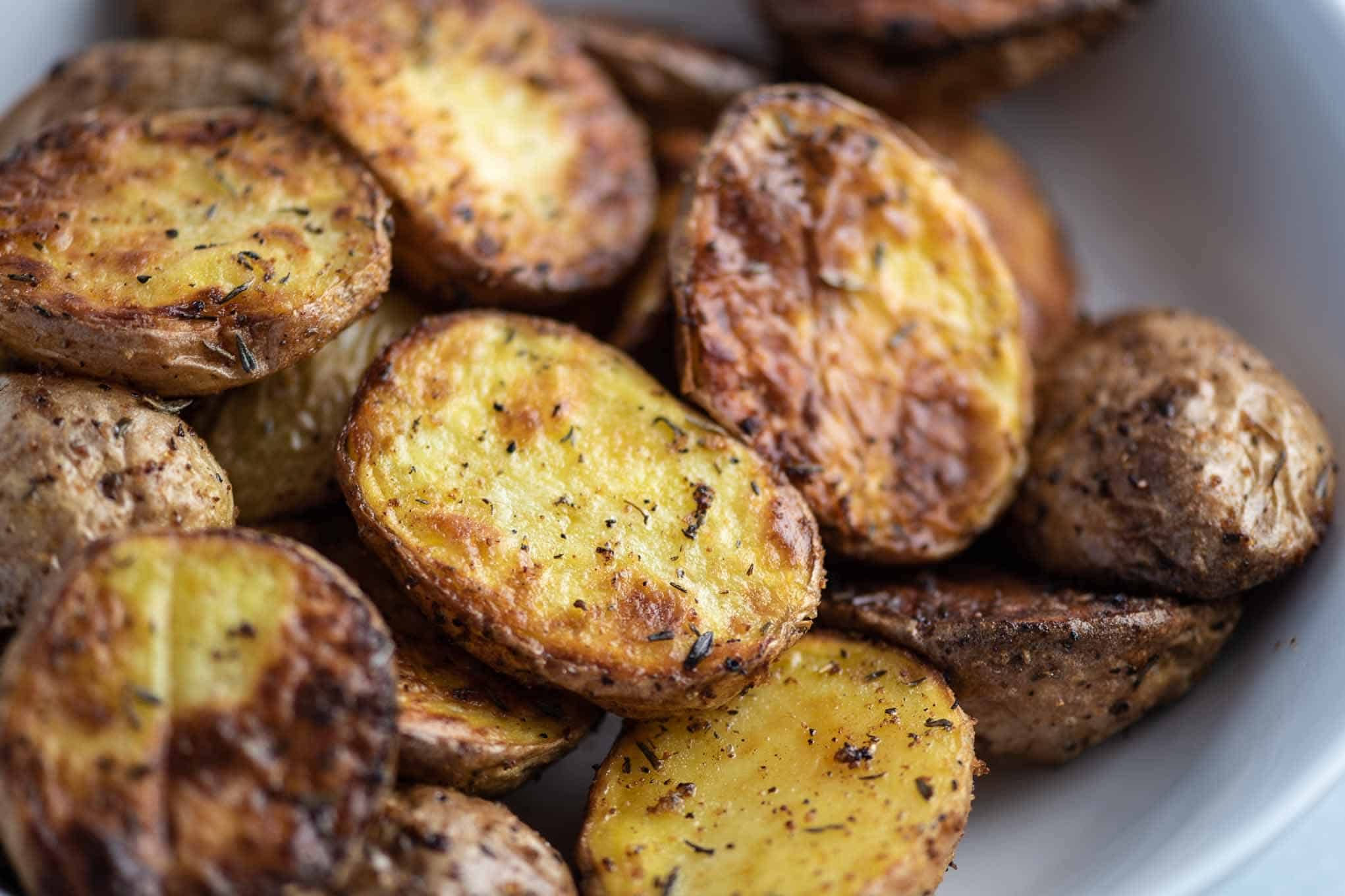 crispy baby potatoes image up close in a white bowl