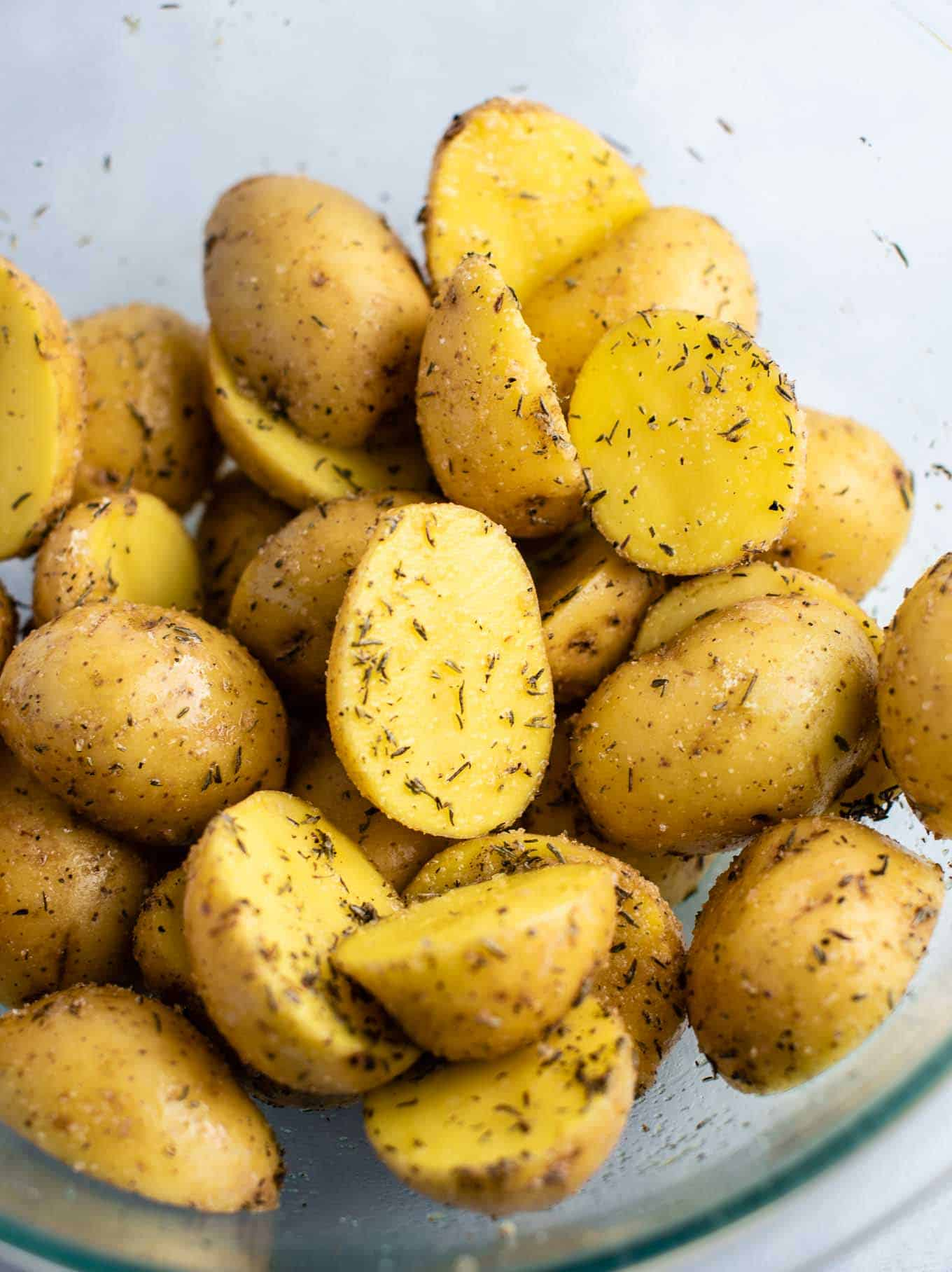 baby gold potatoes with spices and olive oil from an overhead view