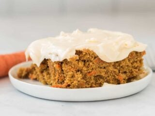 gluten free carrot cake slice on a white plate