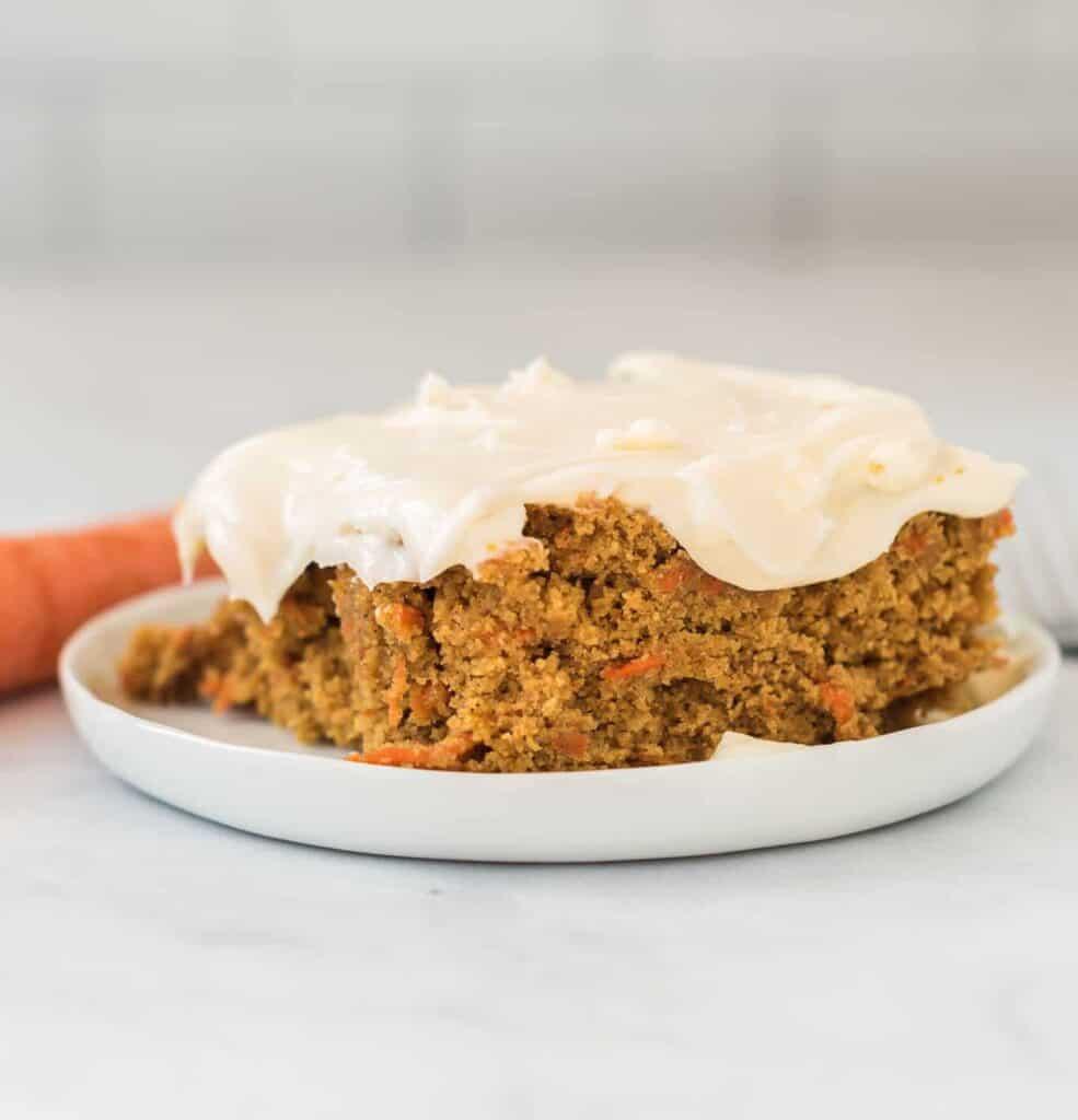 gluten free carrot cake slice on a white plate