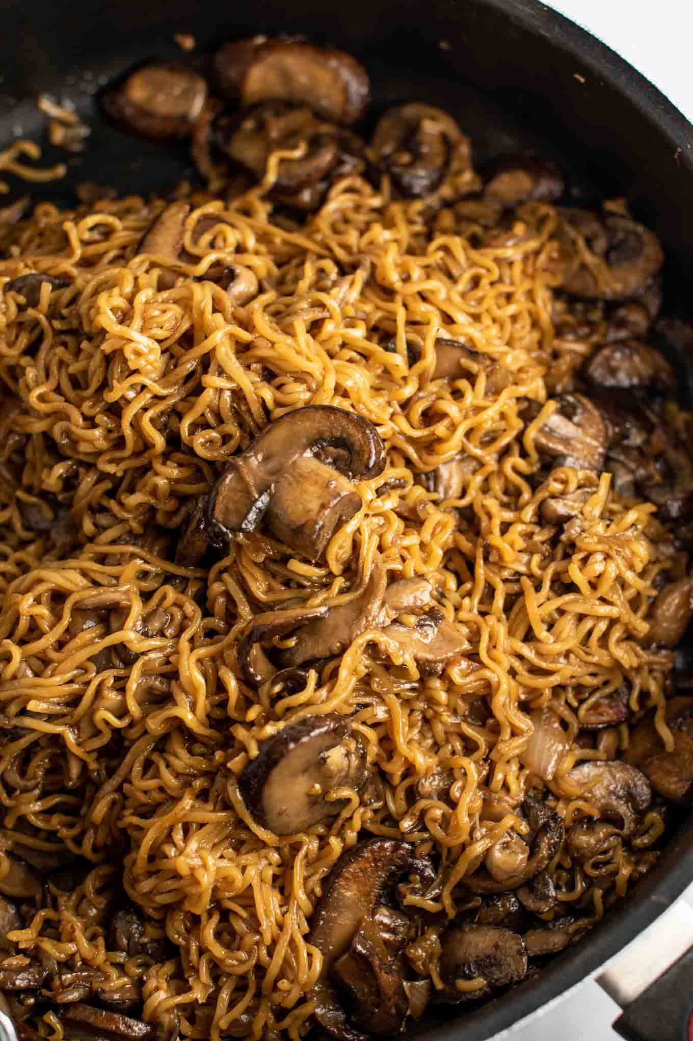 easy ramen stir fry with mushrooms from an overhead view in the pan
