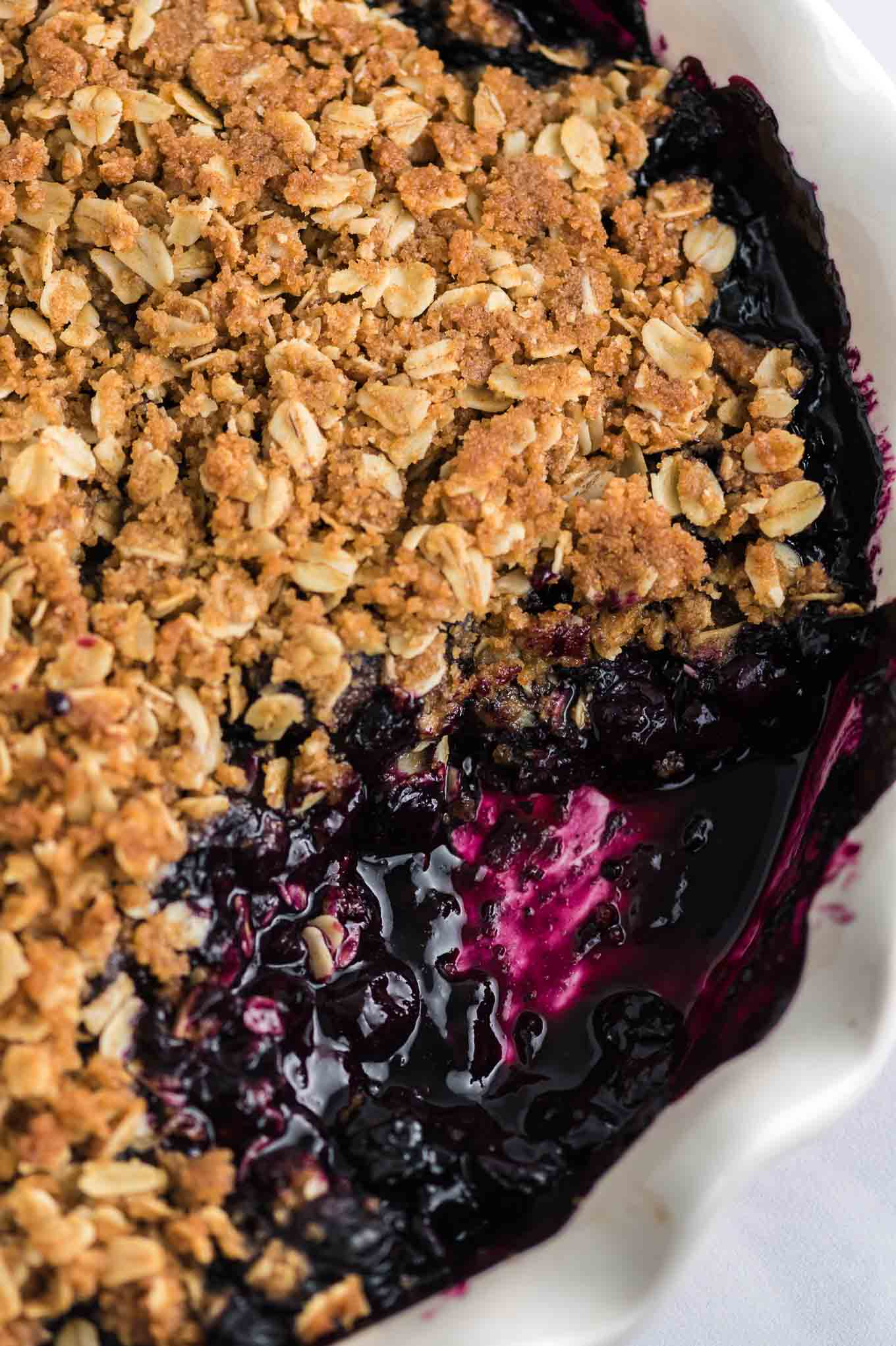 blueberry crisp dish with a spoonful taken out