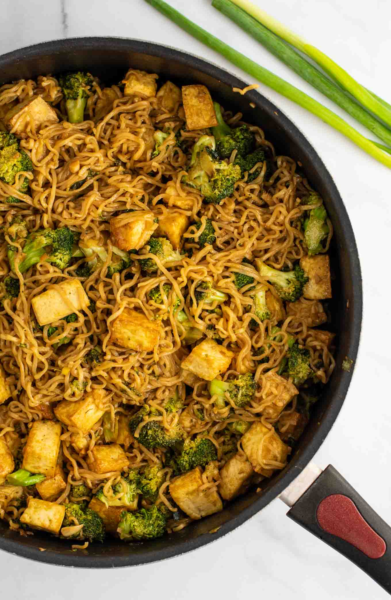 broccoli tofu ramen noodles in a skillet from an overhead view